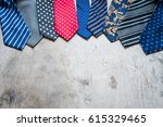 colorful man ties on a wooden... | Shutterstock . vector #615329465