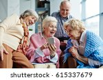 four cheerful elderly people... | Shutterstock . vector #615337679