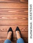 woman standing on wooden floor | Shutterstock . vector #615375545