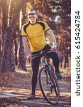 happy man cyclist rides in the... | Shutterstock . vector #615424784