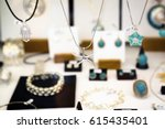 silver star and other jewelry... | Shutterstock . vector #615435401