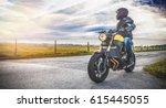 motorbike on the road riding.... | Shutterstock . vector #615445055