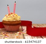 a single cupcake with two... | Shutterstock . vector #615474137