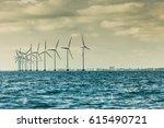 vertical axis wind turbines... | Shutterstock . vector #615490721