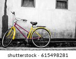 an old yellow bicycle stands... | Shutterstock . vector #615498281