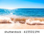 splashing wave on the ocean on... | Shutterstock . vector #615531194