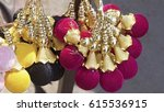 Small photo of colourful soft balls used at india for fashion and beauty its used for. different clothing style people use them in bags and cloths as accessary an Indian street fashion products