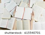 hands holding opened notebook... | Shutterstock . vector #615540701