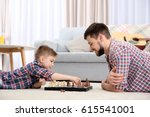 father and son playing chess... | Shutterstock . vector #615541001