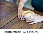 latte art coffee with hand on... | Shutterstock . vector #615545891