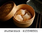 Small photo of traditional chinese food ,chinese steam shrimp dumplings : ha gao in bamboo basket