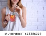 young woman with lemonade near... | Shutterstock . vector #615556319