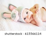 a cute baby girl in a bunny hat.... | Shutterstock . vector #615566114