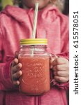 smoothie in the child's hands | Shutterstock . vector #615578051