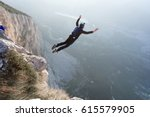 basejumper jumping from the... | Shutterstock . vector #615579905