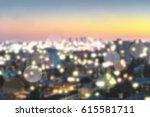 blurred city in evening light... | Shutterstock . vector #615581711