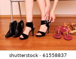 young woman trying on new shoes ... | Shutterstock . vector #61558837