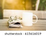 cup of hot coffee and newspaper ... | Shutterstock . vector #615616019