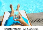 young man lying on sunbed near... | Shutterstock . vector #615620351