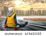 the boy on the skateboard looks ... | Shutterstock . vector #615632105