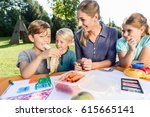 family having breaktime at... | Shutterstock . vector #615665141