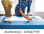 close up. hands woman tailor...   Shutterstock . vector #615667745