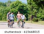 family of four on bike tour in... | Shutterstock . vector #615668015