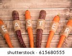 easter carrots on a wooden... | Shutterstock . vector #615680555