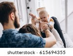 young parents spend time with... | Shutterstock . vector #615694355