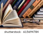 many old books on wooden... | Shutterstock . vector #615694784