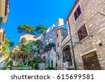 Small photo of Historic view at famous romanesque landmark fortress Mirabela above town Omis, Dalmatia region, Croatia. / Selective focus.