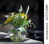 Small photo of Artificial bouquet of leaves of monstera Alismatales , gerbera Transvaal daisy and sunflower in the glass vase on the table