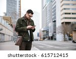 man with the mobile in the city | Shutterstock . vector #615712415