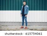 stylish guy standing street in... | Shutterstock . vector #615754061