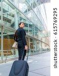 business woman walking by... | Shutterstock . vector #615769295
