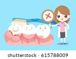 cute cartoon woman dentist with ... | Shutterstock .eps vector #615788009
