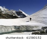 Crossing a glacier atop the Cho La Pass in the Himalaya, Nepal. - stock photo