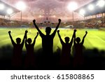 silhouettes of soccer fans in a ...