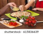 kids making a pizza at home  ...   Shutterstock . vector #615836639