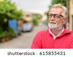 close up of happy handsome... | Shutterstock . vector #615855431