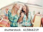 two beautiful smiling women... | Shutterstock . vector #615866219