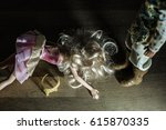 Small photo of Two dolls in fairytale clothes acting out abuse scene - man standing over beaten woman. Domestic violence metaphor.