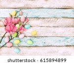 easter eggs and pink magnolia... | Shutterstock . vector #615894899