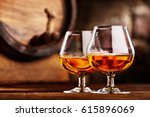 two glass of cognac and old oak ... | Shutterstock . vector #615896069