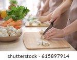woman cutting mushrooms at... | Shutterstock . vector #615897914
