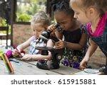 little girls using microscope... | Shutterstock . vector #615915881