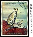 Small photo of STAVROPOL, RUSSIA - April 05, 2017: A stamp printed in Ajman shows Cheetah (Acinonyx jubatus), circa 1967