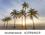 palm trees at sunrise in... | Shutterstock . vector #615964619