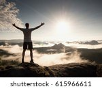 man at the top of a mountain...   Shutterstock . vector #615966611