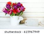 tulip bouquet on  wooden... | Shutterstock . vector #615967949